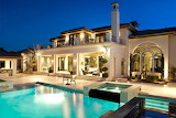 Beautiful luxury white house and pool by night