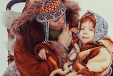 Mother and daughter in native clothing
