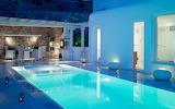 Modern private Greek villa suite and pool at night