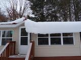 Snow sliding off roof