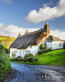 ^ Thatched Cottage at South Milton, Devon, England