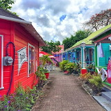 ^ Caribbean colors line a Barbados walkway