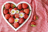 Strawberries in heart-shaped container
