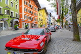 colourful houses and red car