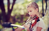 Blonde girl play violin