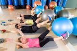 Girl-man-group-fitness-ball-training-gym