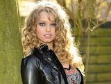 Blonde model in black jacket