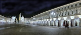 Night cobble stoned square Aurora Torino Piemonte