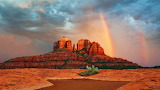 A rainbow forms next to Cathedral Rock, Sedona, Arizona - reddit
