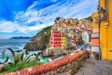 colored houses by the sea in Italy