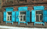 Old wooden house with blue windows-Siberia