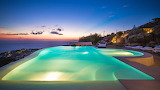 Beautiful seaview hillside pool and terrace at sunset