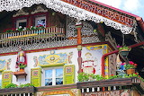Mountain house, chalet, balconies, flowers, statue, dwarf, decor