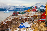 Colored-wooden-houses-village-sea-ice-mountains-greenland