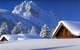 Homes Covered in Deep Snow in the Mountains