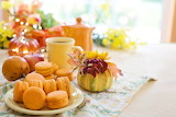 Macarons, pastries, tea, pumpkins, flowers, tablecloth, autumn