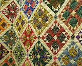 ^ Bear Paw quilt using scraps by Jean Poulton