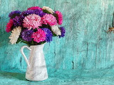 ^ Flowers in a vase