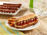 ^ Grilled Spiraled Franks with mustard and ketchup