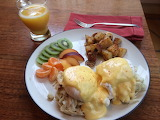 ^ Crab Benedict with Fresh Fruit & Country Potatoes