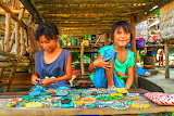 Young girls selling bracelets