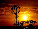 Sunset behind the wind mill