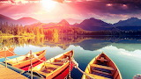 Boats on lake in sunset